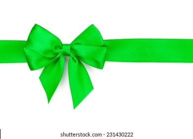 Green ribbon with bow. Isolated on white background