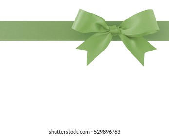 green ribbon with bow isolated on white background, simplicity decoration for add beauty to gift box and greeting card, flat lay close-up top view