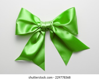Green Ribbon Bow with Real Shadow isolated on White Background