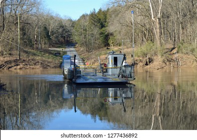 Green River Ferry, one of the few operating rural ferries in America, transports cars across the Green River that bisects Mammoth Cave National Park in Kentucky.