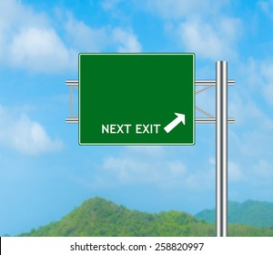 Green Road Sign concept Next Exit and Sky background.