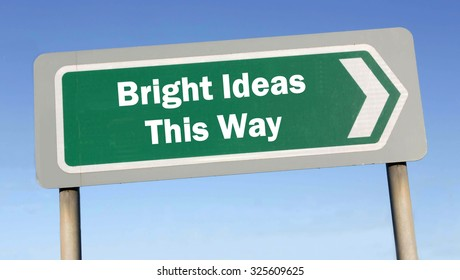 Green road sign with the message of Bright Ideas This Way concept against a blue sky background