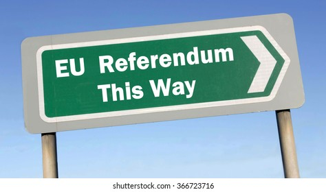 Green road sign with the message of an EU Referendum This Way concept against a blue sky background