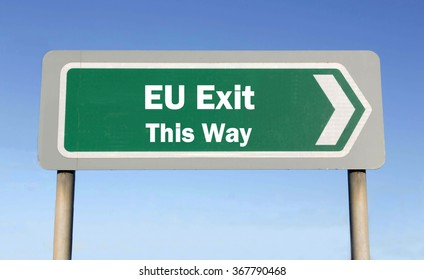 Green road sign with the message of an EU Exit This Way concept against a blue sky background