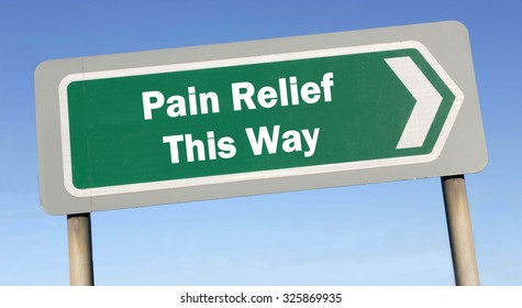 Green road sign with the message of Pain Relief This Way concept against a blue sky background