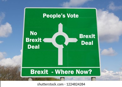 Green roadsign with options for Brexit negotiations including a Bexit deal, no Brexit deal or a People's Vote.