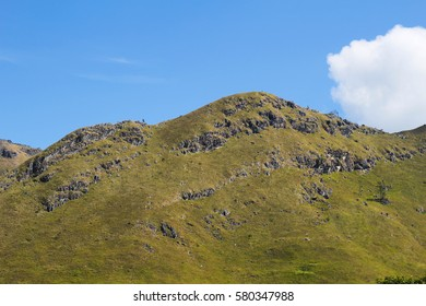 green rock mountain with clear blue sky