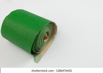 a green roll of rough abrasive paper with the end torn viewed 3/4 from above