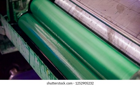 Green rollers of a printing machine unique photo