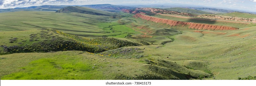 Green rolling hills in the central plains of western Wyoming.