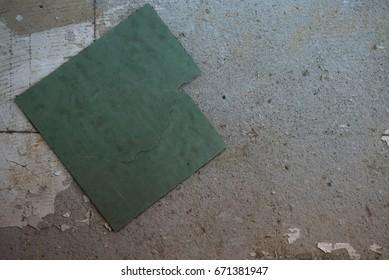 Green rubber tiles deteriorate.