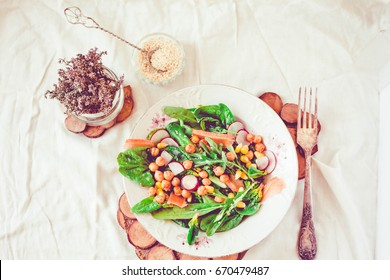 Green salad with arugula, corn, thyme, carrots and baked chickpeas.Healthy lifestyle and Detox diet food concept.