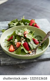 Green salad with feta and strawberry