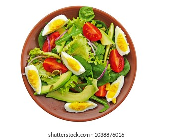 Green salad with healthy leaf vegetable, arugula, baby spinach, avocado, cherry tomatoes, red onions, hard boiled eggs on plate isolated on white. Overhead view.