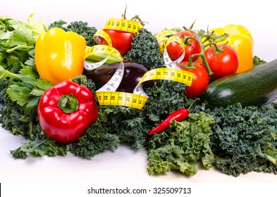 Green salad leaves, measuring tape and vegetables, diet