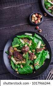 Green salad with liver and spinach on dark rustic background.Selective focus.