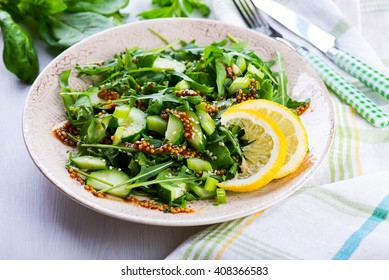 Green salad with onions, celery, spinach and mustard sauce