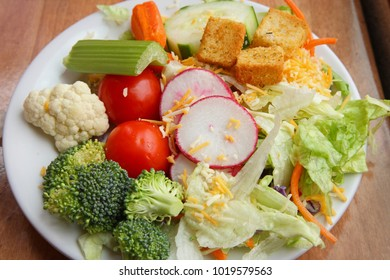 green salad with vegetables on a plate