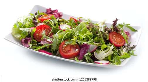 Green salat in a bowl on desk. Tomato, cheese and salad