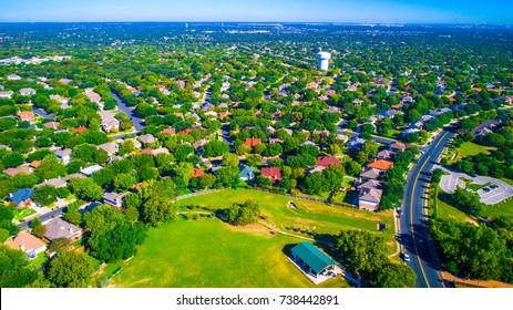Green scape never ending houses and homes Round Rock , Texas , USA Suburb growing outside of Austin high aerial drone view green summer colorful morning Millions of Homes vast Neighborhood Suburbia