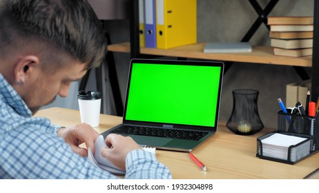 Green screen mock up chroma key display monitor laptop computer concept: Businessman top manager company search information in notebook listen tells investor online video call webcam meeting in office - Shutterstock ID 1932304898