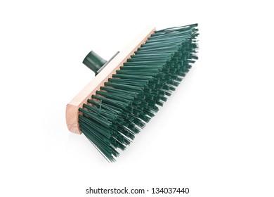 Green scrubbing broom on white background