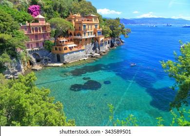 Green sea floor near sunny villas of Portofino, Italy