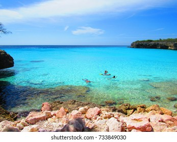 Green sea and rocks in caribbean beach