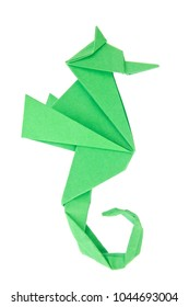 Green seahorse (Hippocampus) of origami, isolated on white background.