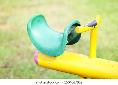 Green seats with handle on seesaw part