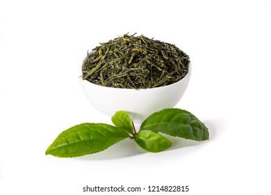 Green sencha tea in white cup with tealeaves in front isolated on white background.
