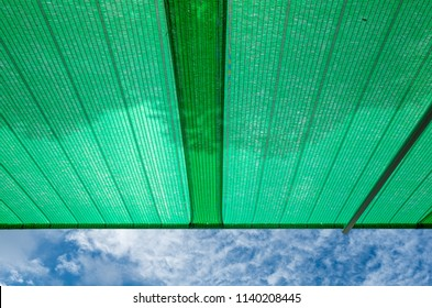 Green shading net roof against with blue sky background