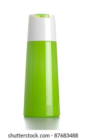 Green shampoo bottle on white isolated