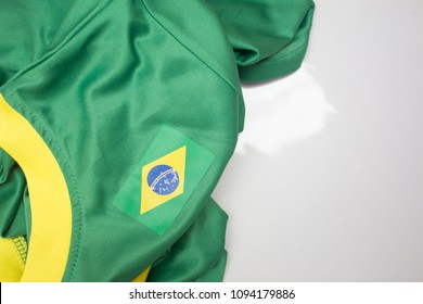 Green shirt with white collar and the flag of Brazil