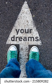 Green shoes standing on your dreams sign