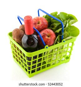 Green shopping basket with daily food isolated over white