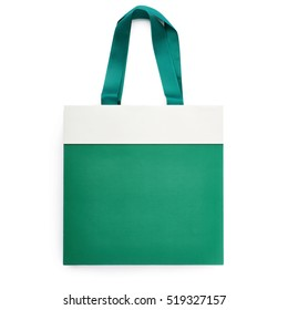 Green shopping or gift bag isolated over the white background