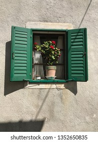 Green shutters on old village house in Hum, the smallest town in the world, Croatia.