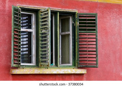 green shutters on red house