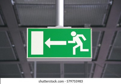green sign for emergency exit in a german railway station