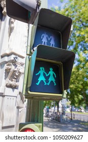 green silhouette of couple of two women holding hand in pedestrian traffic light, public symbol lesbian and gay friendly, in Madrid city streets, Spain Europe