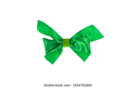 green silk gift bow ribbon isolated on white background