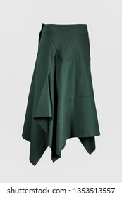 Green skirt isolated on grey background
