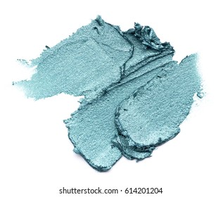 Green smear of creamy eye shadow isolated on a white background.