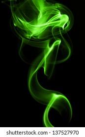 Green smoke in black background