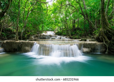 Green and smooth waterfall in the green forest on the mountain, taking this image by long exposure.