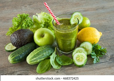 Green smoothie with apples, parsley, spinach, cucumber, avocado and lime