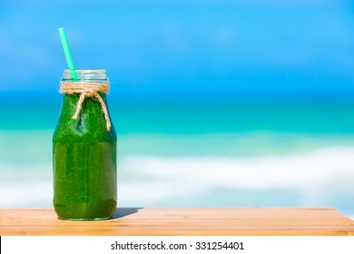 Green smoothie by the beach.