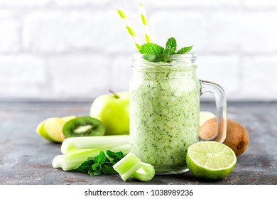 green smoothie with celery, apple, kiwi and lime. healthy diet eating, superfood