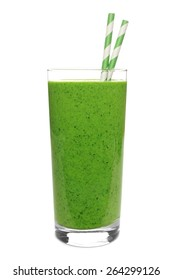 Green smoothie in a glass with straws isolated on a white background